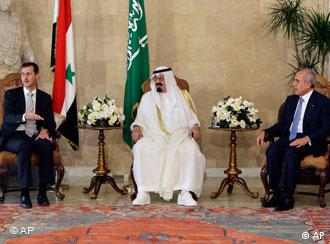 Lebanese President Michel Suleiman, right, meets with Saudi King Abdullah, center, and Syrian President Bashar Assad