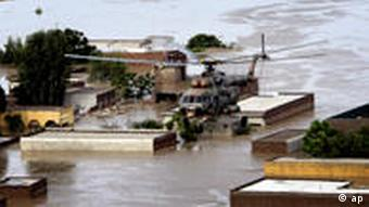 A Pakistan army helicopter evacuates stranded villagers