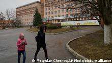 Mother and daughter walk away from the Rivne Regional Children's Hospital, in Rivne, Ukraine, on March 14, 2019. As Ukrainians prepare to go to the polls in a presidential election March 31, millions of Ukrainians have already voted with their feet by leaving the country, seemingly mired in corruption, poverty and conflict. (AP Photo/Mstyslav Chernov)