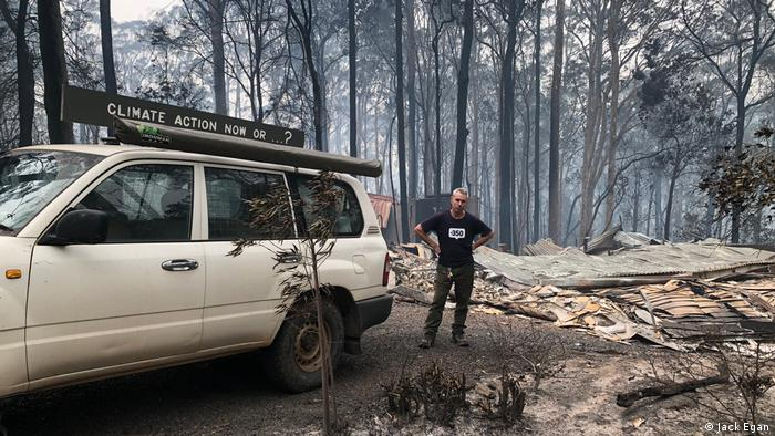 A man stands next to his burned down house in New South Wales, Australia