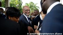 New Prime Minister Ariel Henry, center, talks to members of his cabinet after his appointment in Port-au-Prince, Haiti, Tuesday, July 20, 2021, weeks after the assassination of President Jovenel Moise at his home. (AP Photo/Joseph Odelyn)
