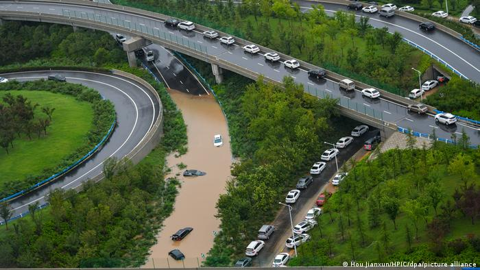 An aerial view of highway roads in Zhengzhou city, with cars submerged in flooding water.