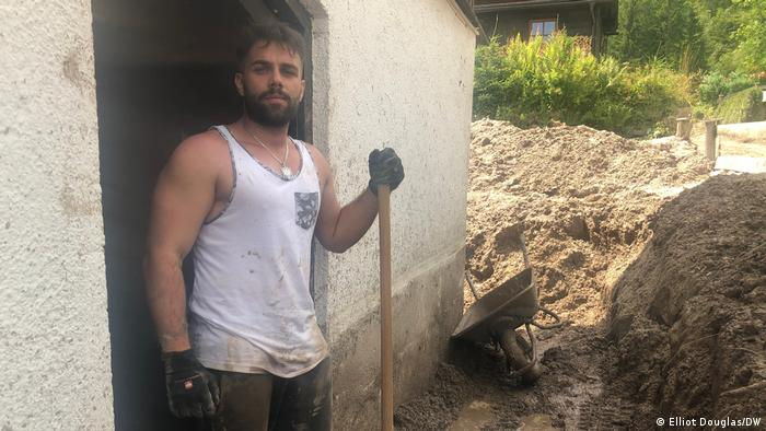 Local Florian poses with a shovel while digging mud in his house