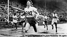 Deutch champion Fanny Blankers-Koen crosses the finish line of the 200m event, in Wembley stadium, London, on July 08, 1948 where she captured four gold medals,100m, 200m, 80m hurdles and 4x100. During her career, Fanny Blankers-Koen won five European champion titles, 80m hurdles, 4x100m, 100m and 200m from 1946 to 1950. (Photo by - / INTERCONTINENTALE / AFP) (Photo by -/INTERCONTINENTALE/AFP via Getty Images)