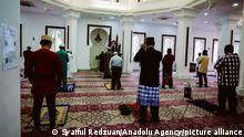 20.07.21 *** KUALA LUMPUR, MALAYSIA - JULY 20: Muslims in Malaysia perform the Eid al-Adha prayers with strict Standard Operation Procedure (SOP) to curb Covid-19 infection at Jamek Mosque in Kuala Lumpur, Malaysia on July 20, 2021 with only 50 people only allowed to be inside. Syaiful Redzuan / Anadolu Agency