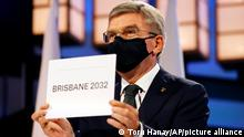 21.07.2021 President of the International Olympic Committee Thomas Bach announces Brisbane as the 2032 Summer Olympics host city during the 138th IOC Session at Hotel Okura in Tokyo, Wednesday, July 21, 2021. (Toru Hanai/Pool Photo via AP)