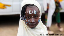 A girl celebrates the Muslim festival of Eid al-Adha in the Kibera slum in Nairobi, Kenya, July 20, 2021. REUTERS/Baz Ratner TPX IMAGES OF THE DAY