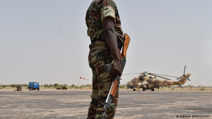 A Niger soldier stands guard at a military airbase