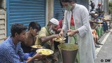 Mehmankhana, a youth organization distributing food to the poor at Eid Day on Dhaka steer