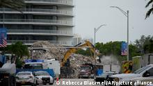 FILE - In this July 12, 2021 file photo, an excavator removes the rubble of the demolished section of the Champlain Towers South building, as recovery work continues at the site of the partially collapsed condo building, in Surfside, Fla. Another victim has been identified in the collapse of a 12-story Florida condominium. The Miami-Dade Police Department said in a news release Saturday, July 17, that Theresa Velasquez, 36, was a confirmed fatality in the June 24 collapse of the Champlain Towers South condo. (AP Photo/Rebecca Blackwell, File)