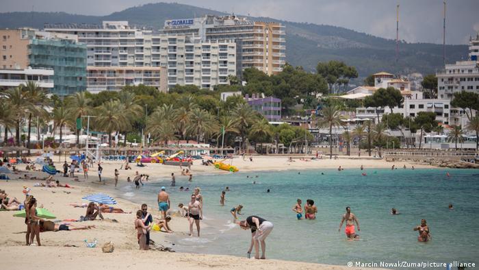 Turistas en la playa, Mallorca.