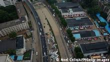 An aerial view shows cars sitting in floodwaters at the entrance of a tunnel after heavy rains hit the city of Zhengzhou in China's central Henan province on July 22, 2021. (Photo by Noel Celis / AFP) (Photo by NOEL CELIS/AFP via Getty Images)