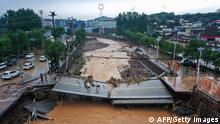 TOPSHOT - This aerial photo taken on July 21, 2021 show a damaged bridge following heavy rains which caused severe flooding in Gongyi in China's central Henan province. - China OUT (Photo by STR / AFP) / China OUT (Photo by STR/AFP via Getty Images)