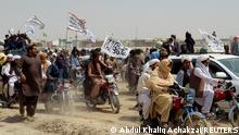 People on vehicles, holding Taliban flags, gather near the Friendship Gate crossing point in the Pakistan-Afghanistan border town of Chaman, Pakistan July 14, 2021. Picture taken July 14, 2021. REUTERS/Abdul Khaliq Achakzai NO RESALES. NO ARCHIVE. REFILE – CORRECTING INFORMATION