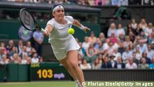 LONDON, ENGLAND - JULY 06: Ons Jabeur of Tunisia plays a forehand in her Ladies' Singles Quarter-Final match against Aryna Sabalenka of Belarus during Day Eight of The Championships - Wimbledon 2021 at All England Lawn Tennis and Croquet Club on July 06, 2021 in London, England. (Photo by AELTC/Florian Eisele - Pool/Getty Images)