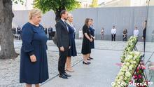 (L-R) Norway's Prime Minister Erna Solberg, Crown Prince Haakon Magnus, Crown Princess Mette-Marit, Utoya massacre survivor Astrid Eide Hoem and the leader of the National Support Group Lisbeth Kristine Royneland attend a wreath-laying ceremony during the memorial service in the Government Quarter in Oslo, on 22 July 2011, ten years after a right-wing extremist killed 77 people in twin attacks. - Norway was plunged into horror on July 22, 2011, when right-wing extremist Anders Behring Breivik killed dozens in a bomb attack in central Oslo and a shooting spree on the island of Utoya. (Photo by Geir Olsen / NTB / AFP) / Norway OUT