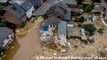 A destroyed house is seen in Erftstadt-Blessem, Germany, Saturday, July 17, 2021. Due to strong rain falls the small Erft river went over the banks causing massive damages. (AP Photo/Michael Probst)