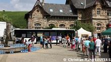 People queue to receive a dose of the vaccine against the coronavirus disease (COVID-19) in a bus, after floods caused by heavy rainfalls, in Ahrweiler Bad Neuenahr-Ahrweiler, Rhineland-Palatinate state, Germany, July 20, 2021. REUTERS/Christian Mang