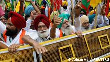 Farmers shout slogans as they arrive in a bus to attend a sit-in protest against the farm laws, near parliament house, in New Delhi, India, July 22, 2021. REUTERS/Adnan Abidi