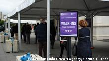 People wait outside a COVID-19 vaccination center in Melbourne, Australia, on May 28, 2021.