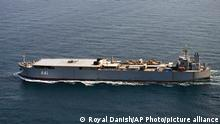 In this handout photo from the Royal Danish Air Force, the Iranian navy vessel Makran is seen sailing through the Baltic Sea off the island of Bornholm, a Danish island in the Baltic Sea off the south coast of Sweden, on Thursday, July 22, 2021. The Danish military said Thursday it spotted an Iranian destroyer and a large support vessel sailing through the Baltic Sea, likely heading to Russia for a military parade in the coming days. (Royal Danish Air Force via AP)