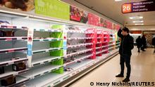FILE PHOTO: A man stands next to shelves empty of fresh meat in a supermarket, as the number of worldwide coronavirus cases continues to grow, in London, Britain, March 15, 2020. REUTERS/Henry Nicholls//File Photo