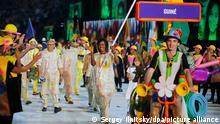 epa05457450 Flag bearer Mamadama Bangoura (C) of Guinea leads her team into the Maracana Stadium during the Opening Ceremony of the Rio 2016 Olympic Games in Rio de Janeiro, Brazil, 05 August 2016. EPA/SERGEY ILNITSKY ++