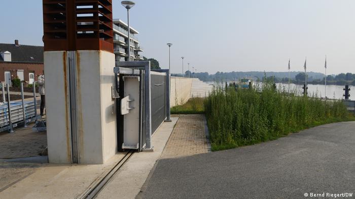 A flood wall with steel gates