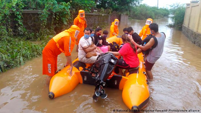 National Disaster Response Force (NDRF) shows NDRF personnel rescuing people
