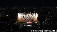Tokyo 2020 Olympics - The Tokyo 2020 Olympics Opening Ceremony - Olympic Stadium, Tokyo, Japan - July 23, 2021. Fireworks during the opening ceremony are seen above the Olympic Stadium, from the Shibuya Sky observation deck REUTERS/Kim Kyung-Hoon
