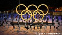 Tokyo 2020 Olympics - The Tokyo 2020 Olympics Opening Ceremony - Olympic Stadium, Tokyo, Japan - July 23, 2021. Performers and the Olympic rings seen during the opening ceremony REUTERS/Dylan Martinez