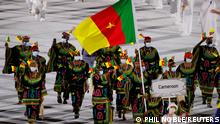 Tokyo 2020 Olympics - The Tokyo 2020 Olympics Opening Ceremony - Olympic Stadium, Tokyo, Japan - July 23, 2021. Flagbearers Joseph Essombe Tiako of Cameroon and Albert Mengue Ayissi of Cameroon lead their contingent in the athletes parade during the opening ceremony REUTERS/Phil Noble