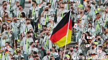 Germany's delegation parade during the opening ceremony of the Tokyo 2020 Olympic Games, at the Olympic Stadium, in Tokyo, on July 23, 2021. (Photo by Martin BUREAU / AFP)