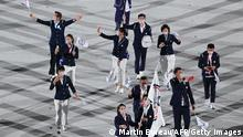 Taiwan's flag bearer Hsing-Chun Kuo and Taiwan's flag bearer Lu Yen-Hsun lead the delegation during the opening ceremony of the Tokyo 2020 Olympic Games, at the Olympic Stadium, in Tokyo, on July 23, 2021. (Photo by Martin BUREAU / AFP) (Photo by MARTIN BUREAU/AFP via Getty Images)