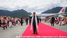 (210723) -- LHASA, July 23, 2021 (Xinhua) -- Chinese President Xi Jinping, also general secretary of the Communist Party of China (CPC) Central Committee and chairman of the Central Military Commission, arrives at the Nyingchi Mainling Airport and is warmly welcomed by local people and officials of various ethnic groups in southwest China's Tibet Autonomous Region, July 21, 2021. Xi visited the Tibet Autonomous Region from Wednesday to Friday. He extended congratulations to the 70th anniversary of Tibet's peaceful liberation and visited officials and ordinary people of various ethnic groups. (Xinhua/Li Xueren)