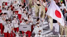 TOKYO, JAPAN - JULY 23: Flag bearers Yui Susaki and Rui Hachimura of Team Japan lead their team in during the Opening Ceremony of the Tokyo 2020 Olympic Games at Olympic Stadium on July 23, 2021 in Tokyo, Japan. (Photo by Patrick Smith/Getty Images)