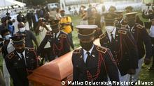 Police carry the coffin of slain Haitian President Jovenel Moise. Cap-Haitien, July 23, 2021.