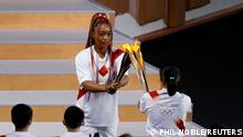 Tokyo 2020 Olympics - The Tokyo 2020 Olympics Opening Ceremony - Olympic Stadium, Tokyo, Japan - July 23, 2021. The Olympic torch is carried during the opening ceremony REUTERS/Phil Noble