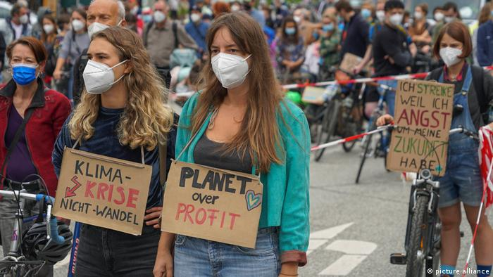 Hundreds gathered in Hamburg Friday to remember flood victims and call on politicians to be more attentive to the climate crisis