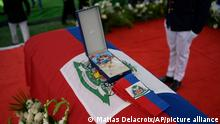 A presidential sash lays on the casket of slain Haitian President Jovenel Moise during his funeral at his family home in Cap-Haitien, Haiti, Friday, July 23, 2021. Moise was assassinated at his home in Port-au-Prince on July 7. (AP Photo/Matias Delacroix)