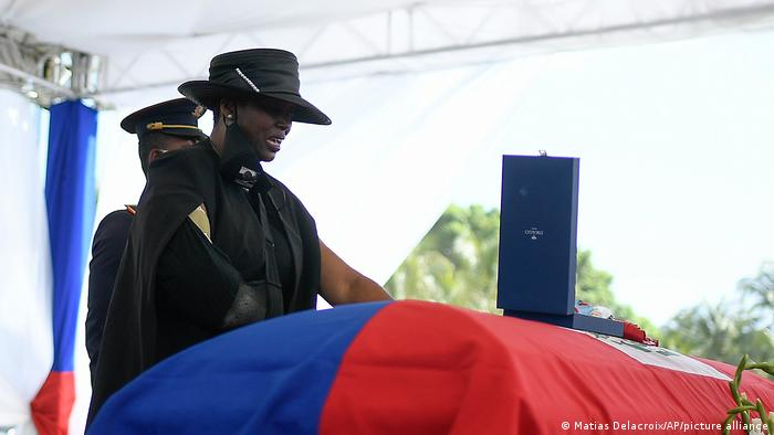 Former first lady of Haiti, Martine Moise, stands over the casket of her slain husband