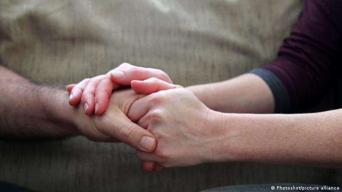 A person holding another person's hand