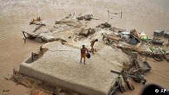 Villagers stranded on a rooftop