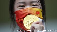 6604019 24.07.2021 Gold medallist Yang Qian of China celebrates on the podium at the victory ceremony after the women's 10m air rifle final competition at the Tokyo 2020 Olympic Games at Asaka Shooting Range in Tokyo, Japan. Grigory Sysoev / Sputnik