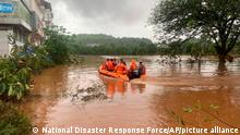23.07.2021 This photograph provided by India's National Disaster Response Force (NDRF) shows NDRF personnel rescuing residents in Chiplun area in the western Indian state of Maharashtra, Friday, July 23, 2021. Officials say landslides and flooding triggered by heavy monsoon rain have killed more than 100 people in western India. More than 1,000 people trapped by floodwaters have been rescued.(National Disaster Response Force via AP)