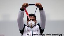 Schießen: Olympia, Finale, Luftpistole 10 m, Männer, in der Asaka Shooting Range. Javad Foroughi aus Iran jubelt über Gold.