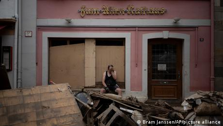 People in western Germany are returning to towns and villages devastated by severe floods more than a week ago.