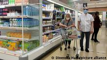 July 19, 2021, London, UK, UK: London, UK. Shoppers wearing face coverings in Sainsbury's superstore in north London. The Covid-19 measure of wearing face coverings is no longer mandatory as the legal requirement ends today, Freedom Day. The government recommends that people continue to wear a face covering in crowded and enclosed spaces. Shoppers shopping in Sainsbury's will need to carry on wearing face coverings. (Credit Image: © Dinendra Haria/London News Pictures via ZUMA Press Wire