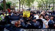 French riot mobile gendarmes face protesters, some wearing yellow vests, during a demonstration against the compulsory vaccination for certain workers and the mandatory use of the health pass called by the French government in Paris on July 24, 2021. - Since July 21, people wanting to go to in most public spaces in France have to show a proof of Covid-19 vaccination or a negative test, as the country braces for a feared spike in cases from the highly transmissible Covid-19 Delta variant. (Photo by Sameer Al-DOUMY / AFP) (Photo by SAMEER AL-DOUMY/AFP via Getty Images)