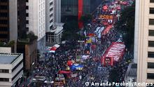 People attend a protest to demand the impeachment of Brazil's President Jair Bolsonaro and against his handling of the coronavirus disease (COVID-19) pandemic, at Paulista Avenue in Sao Paulo, Brazil, July 24, 2021. REUTERS/Amanda Perobelli